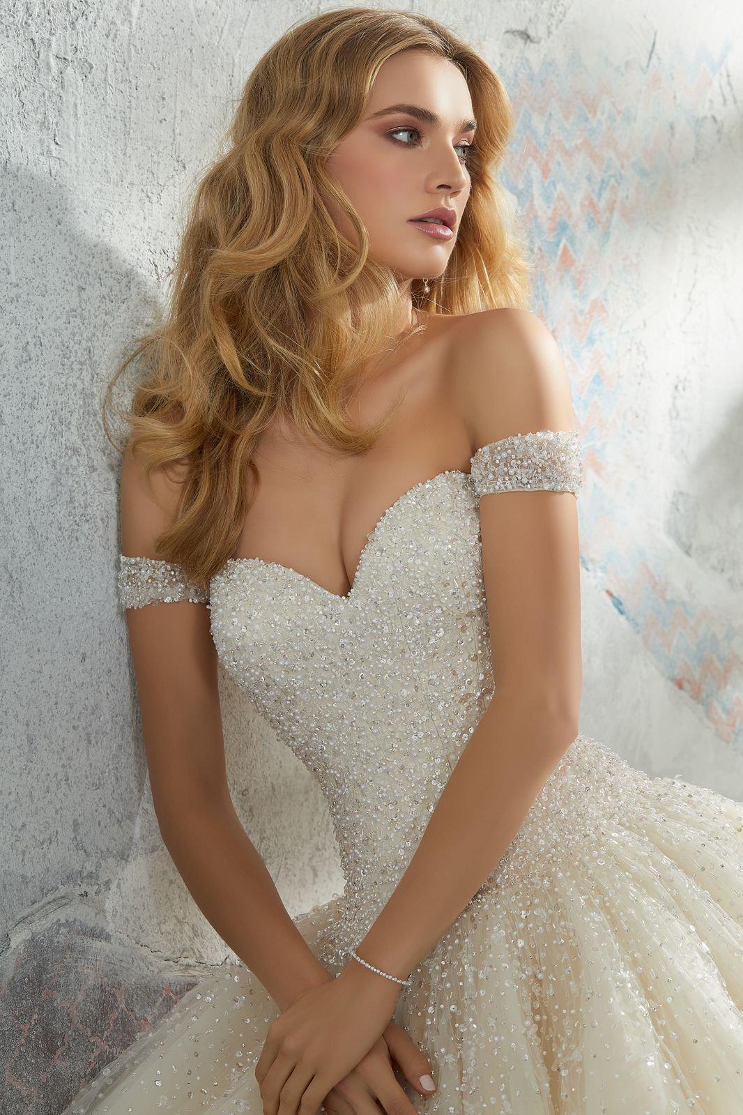 8291 - Suknie ślubne